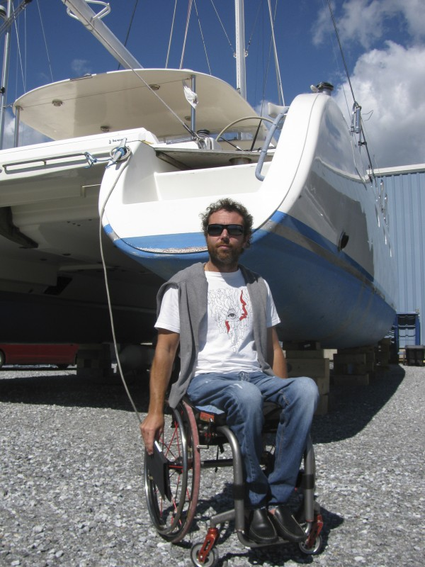 Italian sailor Andrea Stella, 35, had his 56-foot-long catamaran hauled out of the ocean at the Front Street Shipyard in Belfast to avoid Tropical Storm Irene. The handicapped-accessible sailboat is the centerpiece of his nonprofit organization which helps disabled people to have a chance to go sailing for free.