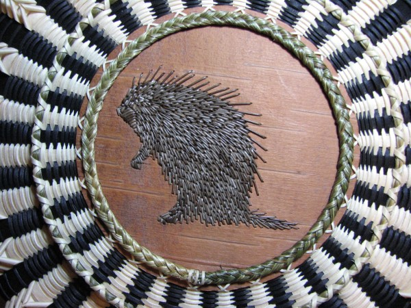 Porcupine quillwork on birch bark embellishes the top of a basket made by Jeremy Frey, Passamaquoddy basketmaker of the Indian Township in Princeton.