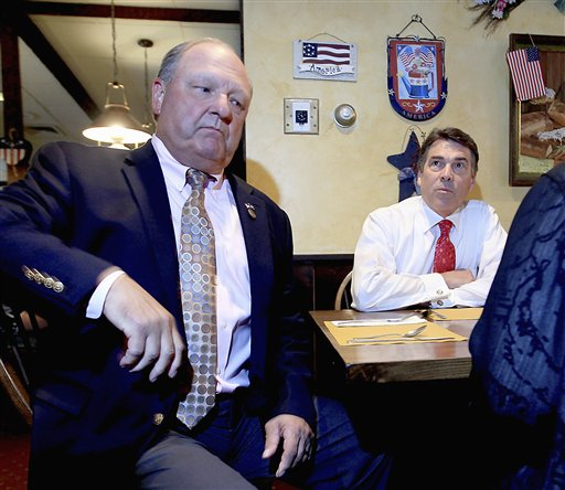 In August, Republican presidential candidate, Texas Gov. Rick Perry, right, sat down for lunch with N.H. GOP Chairman Jack Kimball, left, and others at a coffee shop in downtown Dover, N.H.