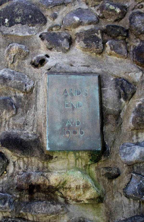 The Land's End plaque is set in one of two stone pillars at the entrance to Russell Porter's colony.