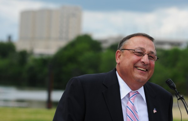 Gov. Paul LePage speaks before signing a pair of bills along the Bangor Waterfront in July.