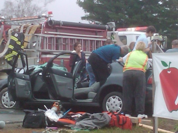 Emergency crews from Levant Fire and Rescue and Maine State Police help a male passenger get out of a 1996 Honda Accord after the Jaws of Life were used to rip the roof off the vehicle. 22-year-old Mary Beth Kelson of Turner, who was driving the car, was heading west on Route 222 in Levant and attempted to make a left-hand turn onto Pember Road when her car collided with a pickup truck with four occupants.