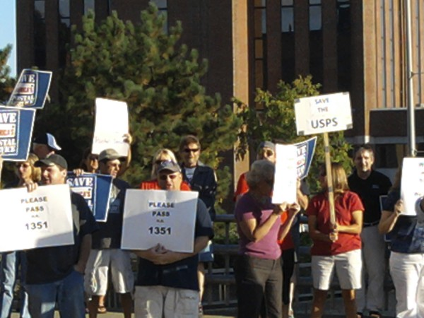 U.S. Postal Service workers participate in a rally Tuesday, Sept. 27, 2011 on State Street in Bangor. The workers said instead of downsizing to survive, Congress has the power to restore its financial footing without spending a dime of taxpayer money.