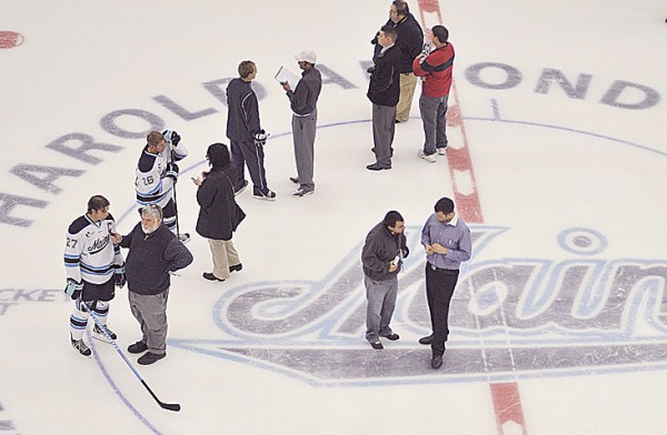 Members of the media interview players and coaches for the UMaine ice hockey team in Orono Thursday, Sept. 29, 2011.