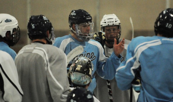 UMaine hockey captain Will O'Neill instructs players during a captain's practice on Wednesday at the Penobscot Ice Arena in Brewer. Players have been working on captain's practices since the start of the school year, and coaches will be able to get on the ice with them in a limited way until the first official practice on Oct. 1.
