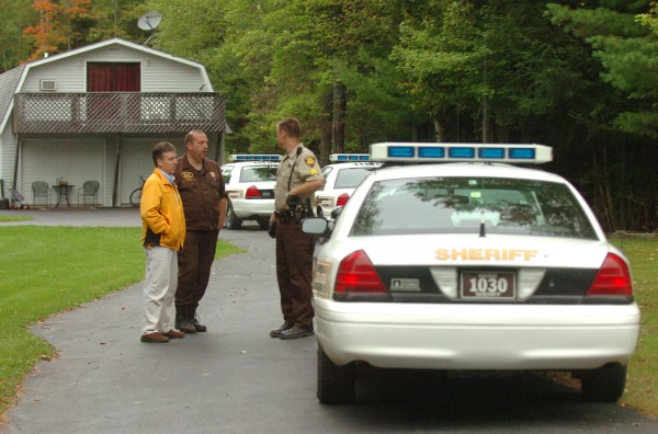Law enforcement officals in front of the Milford home of Daniel R. Pattershall, 45, as they execute a search warrant on the property, on Thursday, September 22, 2011. Pattershall was arrested for trafficking in scheduled drugs.