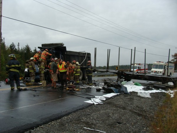 The Piscataquis County Sheriff's Department, the Maine State Police Truck Weight Unit, firefighters from Greenville, Monson and Guilford and emergency responders on the scene of a collision between a dump truck and a tractor-trailer on Route 15 at the sharp curve at Spectacle Pond in Monson. The accident occurred around 12:30 p.m.