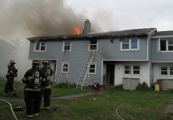 Smoke and flames erupt from the rooftop of an apartment complex on Moosehead Boulevard in Bangor on Tuesday.
