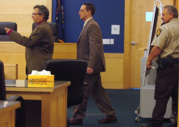 Nathaneal Nightingale (center) follows defense attorney, Jeffrey Silverstein, into the courtroom at the start of Nightingale's sentencing at the Penobscot Judicial Center in Bangor on Tuesday, September 27, 2011. Nightingale received 40 years for murder, with 15 years concurrent, for the 2009 death of Michael Miller, Sr., and Valerie Miller, at the couple's Webster Plantation home.