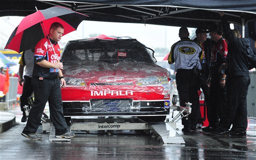 Sprint Cup Series driver Tony Stewart's crew prepare to move his car to the garage during a rainstorm before the scheduled NASCAR Atlanta Sprint Cup AdvoCare 500 auto race, Sunday, Sept. 4, 2011, at the Atlanta Motor Speedway, in Hampton, Ga.