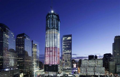 One World Trade Center overlooks the ground zero memorial site last night.
