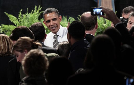 President Barack Obama greets supporters after speaking at a Democratic fundraiser at the Paramount Theater, Sunday, Sept., 25, 2011, in Seattle, Wash.