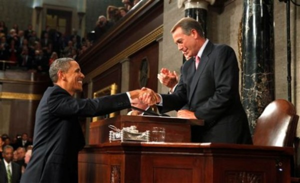 President Barack Obama arrives and shakes hands with House Speaker John Boehner of Ohio before addressing a joint session of Congress on Capitol Hill in Washington, Thursday, Sept. 8, 2011.
