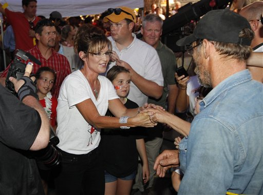 In this Aug. 12, 2011, file photo, former Alaska Gov. Sarah Palin greets the crowd after she was interviewed by Sean Hannity of FOX News at the Iowa State Fair in Des Moines, Iowa. Palin soon will end the will-she-or-won't-she presidential speculation that has trailed her for two years _ and that she has fueled with abandon, perhaps to the detriment of her potential candidacy.  (AP Photo/Charles Dharapak)
