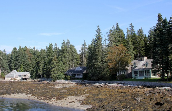 A cluster of Russell Porter cabins line Port Clyde Harbor.