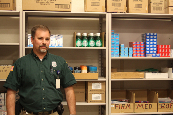 Darrell Curtis, the canteen manager for Maine State Prison, stands in his store. The warehouse is full of personal hygiene products, rice, video game consoles, Snickers bars, fish oil diet supplements and playing cards, among other things.