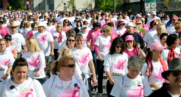 People walk down Main Street in Bangor during the 15th annual Susan G. Komen Race for the Cure in Bangor Sunday morning. More than 5,000 people participated in the event that raises money for breast cancer research.