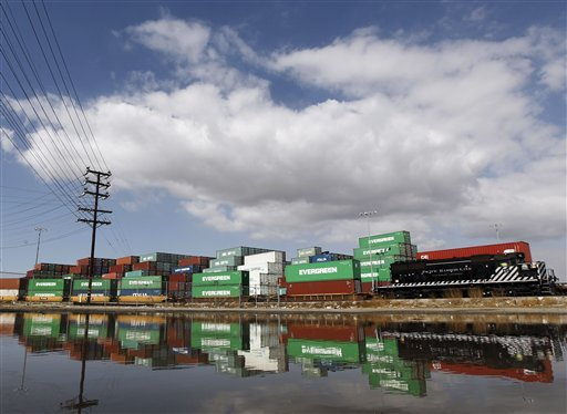 Containers filled with goods are stacked up and awaiting shipment by rail in the Port of Los Angeles near San Padro, Calif.