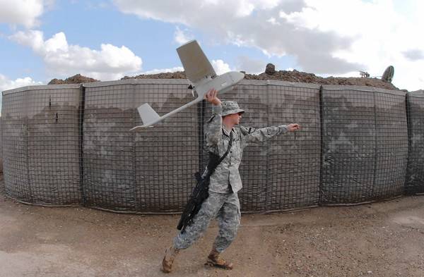 A soldier launches an AeroVironment Raven in Iraq in 2009.