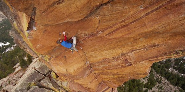 Matt Wilder climbs Cheating Reality on the Devil's Thumb rock formation in Colorado in December 2009.