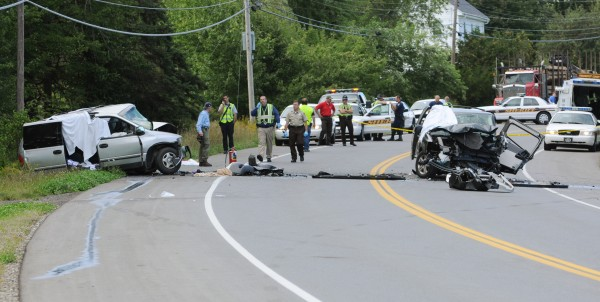 Penobscot Sheriff Deputies along with Maine State Police and Eddington Fire Department first responders are seen on Thursday, September 1, 2011, at the scene of a fatal head-on van crash on Route 9 in Eddington.