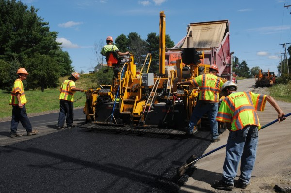 A hot-topping crew puts the final coat on a stretch of Mt. Hope Avenue in Bangor on Thursday, September 1, 2011.