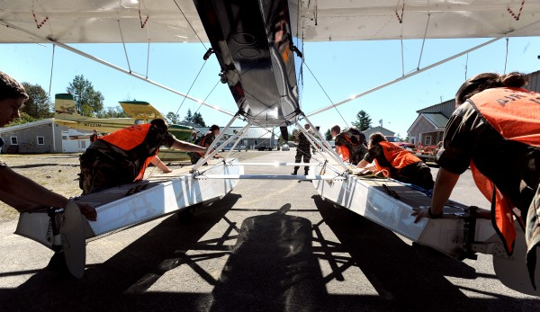 Civil Air Patrol Maine Wing cadets push a seaplane to the launch ramp during the last day of the 38th annual International Seaplane Fly-in in Greenville Sunday.  Town officials estimated that about 10,000 people visited Greenville during the four-day event that.