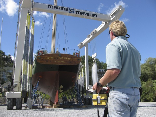 J.B. Turner of the new Front Street Shipyard uses a remote control Tuesday morning to maneuver a marine travel lift around the 90-foot-long schooner called The Spirit of Bermuda. &quotWe bought the land in January. It was an empty, fallow field, basically,&quot he said. &quotSeven or eight weeks later, we're full. That's pretty satisfactory.&quot