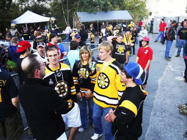 Fans clad in Bruins jerseys and colors collect in a barbecue area set up outside Krista's restaurant in Cornish Wednesday awaiting the arrival of the Stanley Cup.