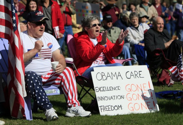 Tea Party supporters cheer during a rally in Capitol Park, Thursday, April 15, 2010, in Augusta, Maine.