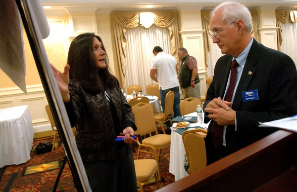 Susan Hammond (left) of Four Directions Development Corporation, discusses economic growth strategies with John Moore of Bangor Savings Bank during the forum &quotGrowing Economies in Indian Country: Taking Stock of Progress and Partnerships&quot on Tuesday, September 20, 2011, at the Hilton Garden Inn in Bangor.