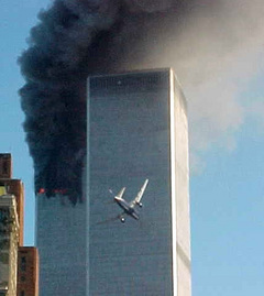 A jet airliner is lined up to hit one of the World Trade Center towers in New York on Tuesday Sept. 11, 2001.