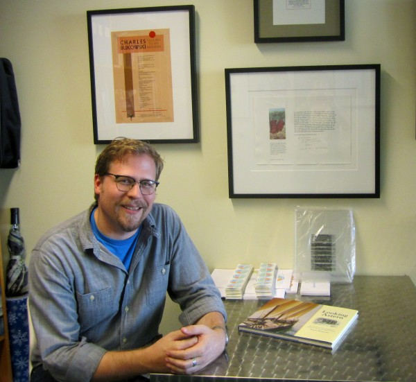 Josh Bodwell, executive director of the Maine Writers and Publishers Alliance, in the MWPA office at the Glickman Library at the University of Southern Maine in Portland.