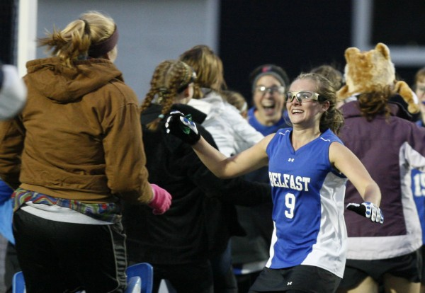 Belfast's Emily Blood (9) celebrates her team's field hockey state championship victory over York in Yarmouth on Saturday, Oct. 29, 2011.