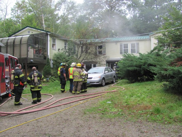 Firefighters from seven towns responded to a structure fire on Saturday, October 1, 2011, at 670 Old Stage Road in Woolwich. Though the home may not be a total loss, Woowich Deputy Fire Chief Phillip Skillin said it will need extensive work before it can be lived in again.