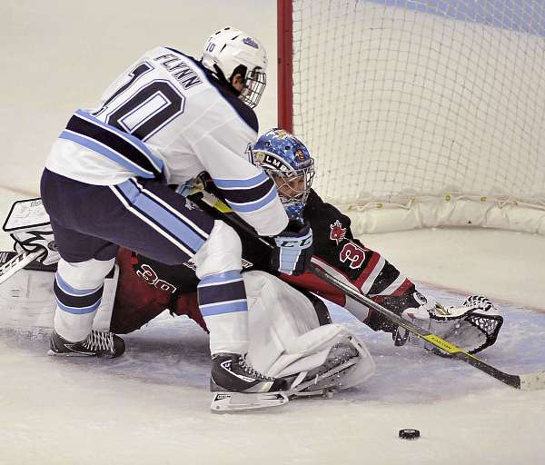 New Brunswick goalie Dan LaCosta (30) makes a skate save on a shot by Maine's Brian Flynn (10) in the first period of their game in Orono Sunday, Oct. 2, 2011.