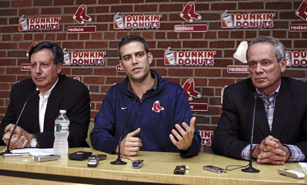 Boston Red Sox owners Tom Werner, left, and Larry Lucchino, right, listen as general manager Theo Epstein speaks during a news conference, Friday, Sept. 30, 2011, in Boston. In a joint statement released on Friday, the Red Sox announced they will not pick up the option on Terry Francona's contract in the wake of the team's September collapse.