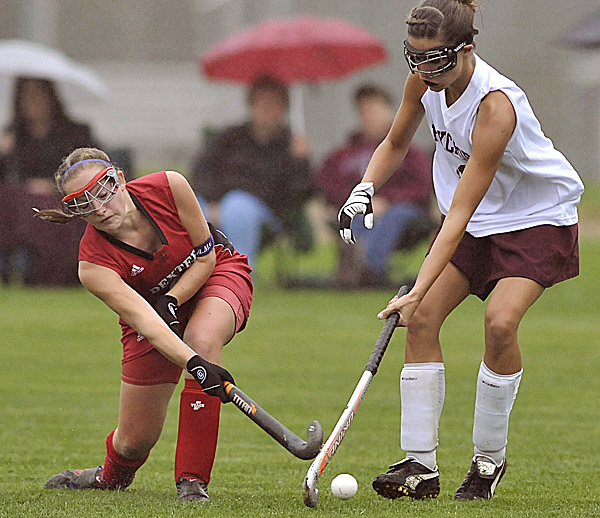 Dexter's Sarah Eastman, left, works the ball under the stick of Foxcroft Academy's Hilary Kendall in the second half in Dover-Foxcroft Monday, Oct. 3, 2011. Eastman scored a last-second goal to lift Dexter to a 1-0 victory.