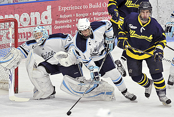 Maine goalie Dan Sullivan (30) and teammate Mark Nemec (3) collide in front of the net after being pushed by Merrimack's Brandon Brodhag (12) during a game last season at Alfond Arena in Orono. The two teams will open Hockey East play Friday night in Orono.