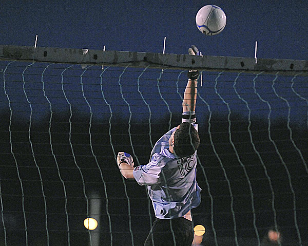Ellsworth 'keeper Thomas Sawyer makes a leaping save on a shot in the second half of Wednesday night's boys soccer game against Presque Isle in Ellsworth. The host Eagles won 4-1.