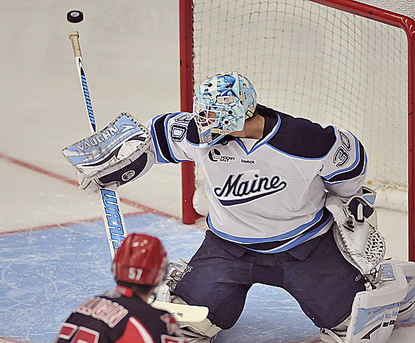 Maine goalie Dan Sullivan makes a pad save in the second period against the University of New Brunswick Sunday at Alfond Arena in Orono. Maine will need improved goaltending this season if it expects to return to the NCAA Tournament.