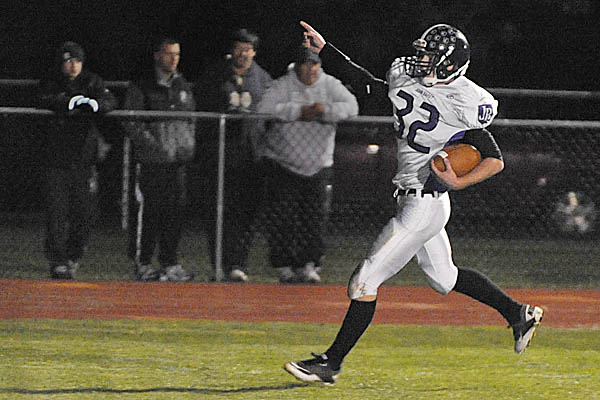 John Bapst Memorial High School running back Andrew Catlin scores the game's first touchdown in the first quarter of Friday night's game against Foxcroft Academy in Dover-Foxcroft.