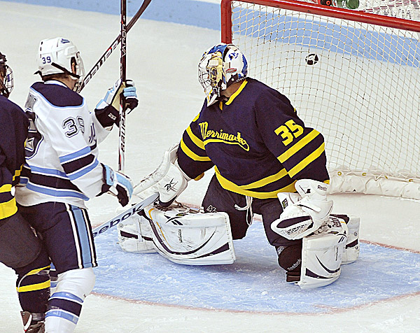 Maine's Joey Diamond (39) waits for a rebound as the puck sails just wide left of Merrimack goalie Joe Cannata (35) in the first period of their game in the Alfond Arena Friday Oct. 7, 2011.