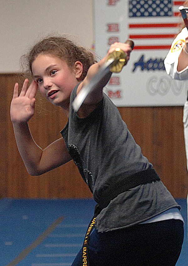 Danielle Barrett, a student at Hampden ATA Martial Arts, practices Wednesday, Oct. 5, 2011.