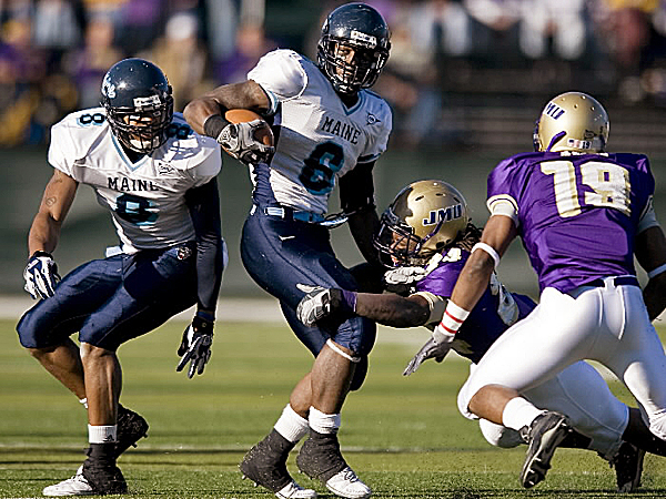 Maine's Derek Session (6) tries to break a tackle during a game against James Madison in 2009. The versatile Session and the Black Bears will host Rhode Island Saturday in Orono at 1 p.m.