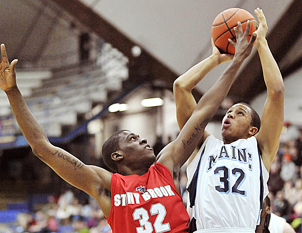 Maine's Gerald McLemore puts up a shot over Stony Brook's Anthony Mayo last season.McLemore, the leading returning scorer in America East with 1,199 career points, was named Thursday to the 2011-12 All- America East Preseason Team.