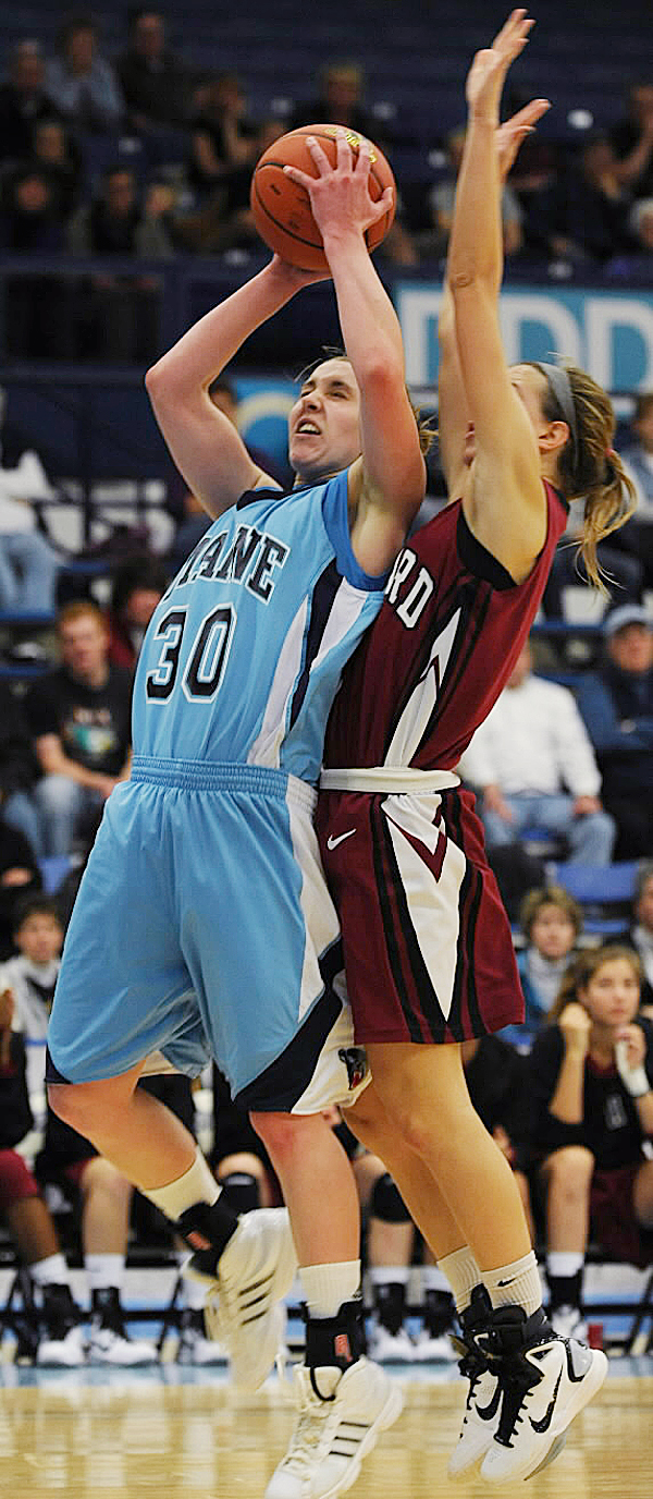 Amber Smith (left) of the University of Maine gets bumped by Harvard's Elle Hagedorn while putting up a shot during a game last season. Smith is a key returning player for the Bears, who have been picked last in the America East preseason poll.