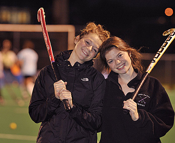 Sisters Emily (left) and Elise Tilton take a break during a John Bapst field hockey practice last year at the University of Maine in Orono.
