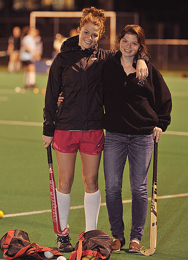Sisters Emily (left) and Elise Tilton take a break during a John Bapst field hockey practice Monday at the University of Maine in Orono.The Tiltons have led John Bapst to the No. 2 seed entering Tuesday's quarterfinal against Gardiner at UMaine. Emily Tilton has scored 33 goals and Elise has recorded 19 this season.