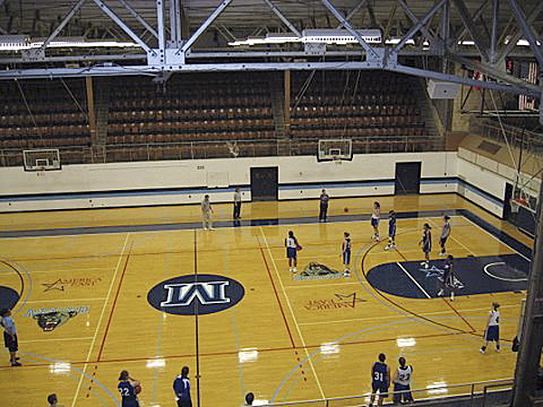 Members of the University of Maine women's basketball team practice at Memorial Gym in Orono.